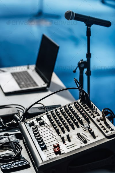 Media Event. Microphone, Sound Mixer And Laptop