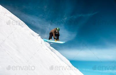 Active man snowboarding