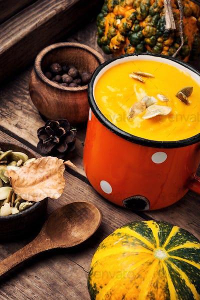 Pumpkin cream soup in mug