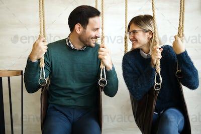 Beautiful couple bonding while in swing