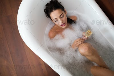 Beautiful woman having a bubble bath