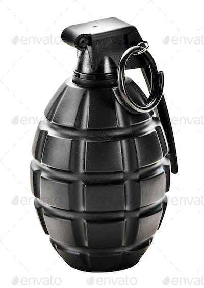 Black grenade standing upright with the pin in