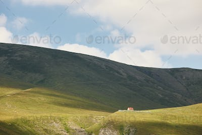 Desolated green mountains landscape with lonely farm house in Spain