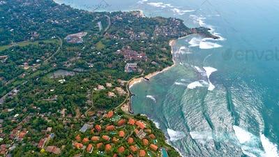 Aerial of  seaside fishermen village in Sri lanka
