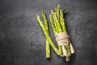 Fresh green asparagus on black slate background