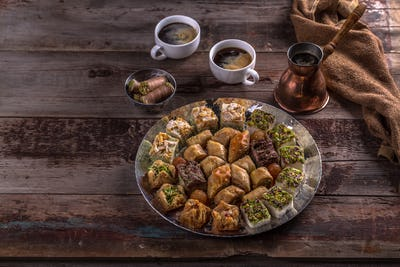 Turkish sweets baklava with coffe on rustic table, copy spacea