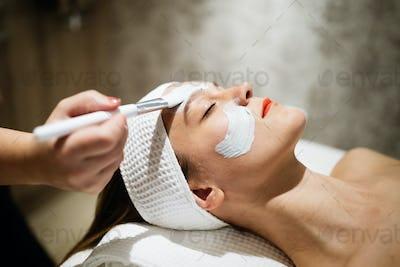 Masseur applying face mask