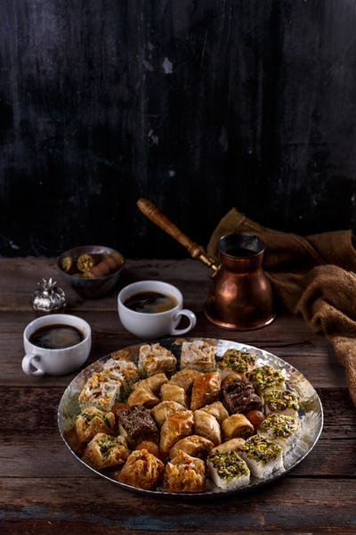 Middle Eastern Dessert Baklava with coffee on silver tray, copy space