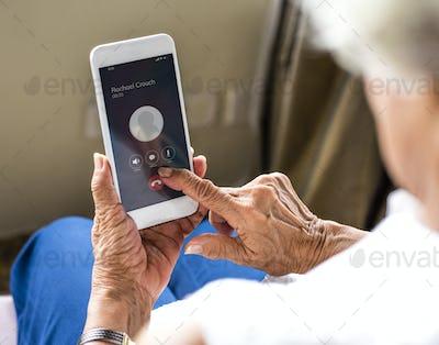 Senior woman hanging up the phone