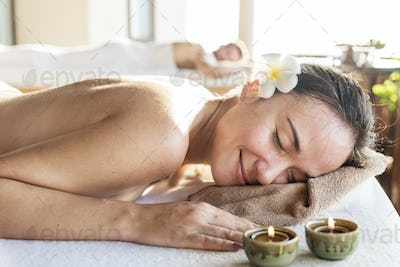 Woman relaxing with a herbal massage