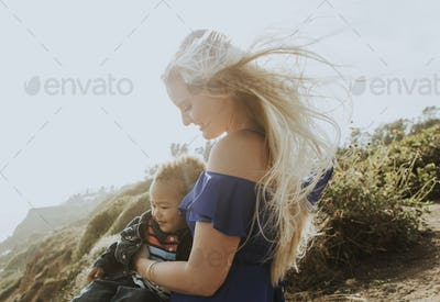 Blonde mom with her son outdoors