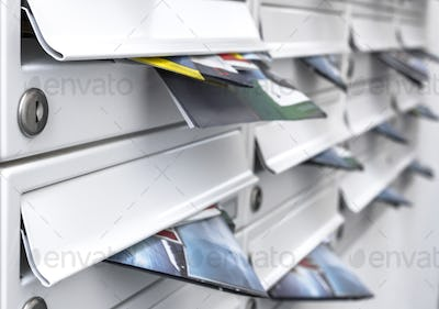 Modern mailboxes filled of flyers