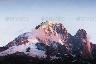 Incredible colorful sunset on Aiguille Verte peak in French Alps