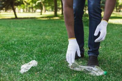 Volunteers collecting recyclable plastic bottles in park