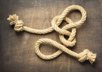 ship rope at wooden background surface