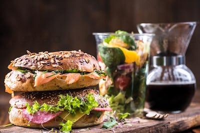 Superfood breakfast idea,bagels,salad and coffee
