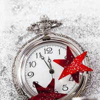 New Year's at midnight - Old clock and holiday lights