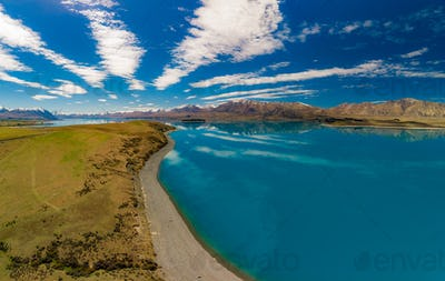 Aerial drone shots of Lake Tekapo with reflection of sky and mou