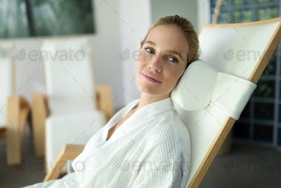 Portrait of beautiful woman relaxing in spa center