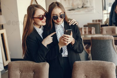 twins with phone