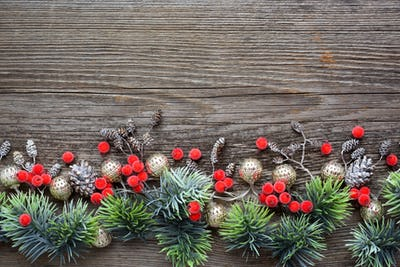 Christmas decorations and spruce branches on a wooden table. Top