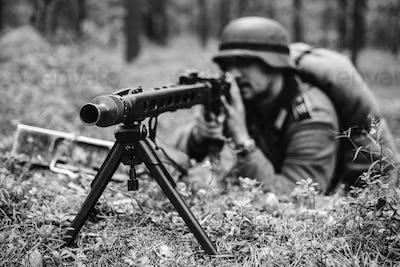 Hidden German Wehrmacht Soldier Aiming A Machine Gun At Enemy Fr