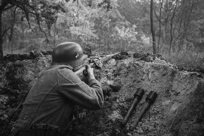 German Wehrmacht Infantry Soldier In World War II Hidden Sitting