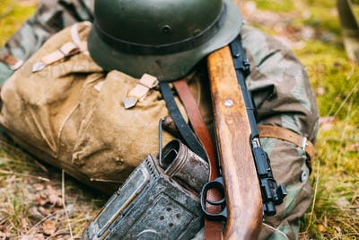 German Ammunition Of World War II On Ground. Military Helmet, Li