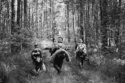German Infantry Soldiers In World War II Marching Walking Along