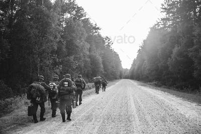 German Infantry Soldier In World War II Marching Walking Along F