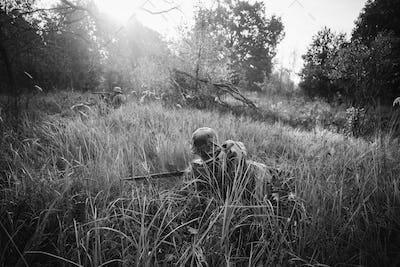 German Wehrmacht Infantry Soldier In World War II Hidden Sitting