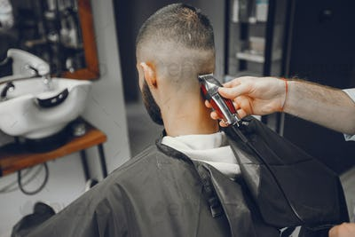 A man cuts hair in a barbershop