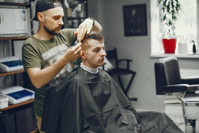 A man cuts hair in a barbershop