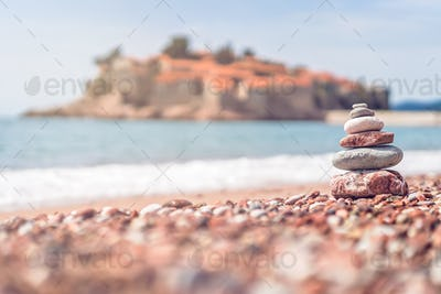 Pile of stacked stones on the beach