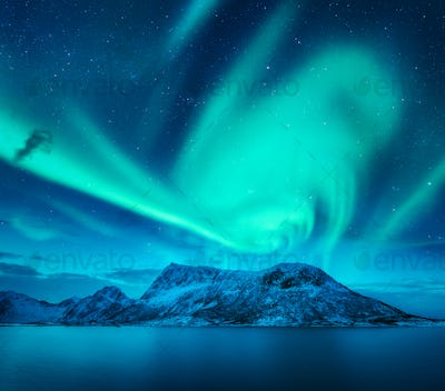Aurora borealis above the snow covered mountain