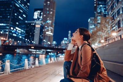 woman walking near Chicago river