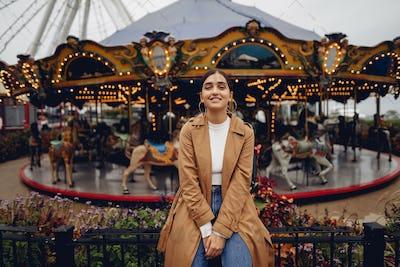 girl walking through the amusement park