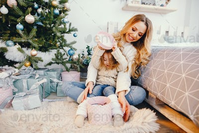 mommy and daughter opening gifts