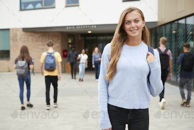 Portrait Of Smiling Female High School Student Outside College Building