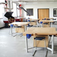 View Of Work Benches And Machinery In High School Design And Technology Classroom