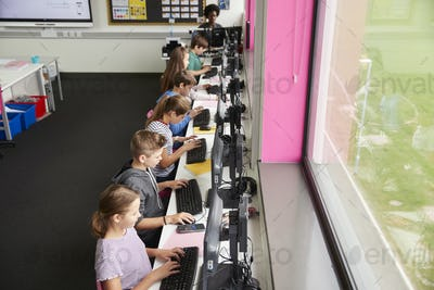 Line Of High School Students Working at Screens In Computer Class