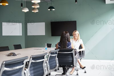 Businesswoman Interviewing Female Candidate At Graduate Recruitment Assessment Day In Office