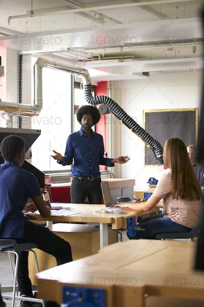 Class Of High School Students Sitting Listening to Teacher