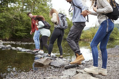 Multi ethnic group of five young adult friends on a hike