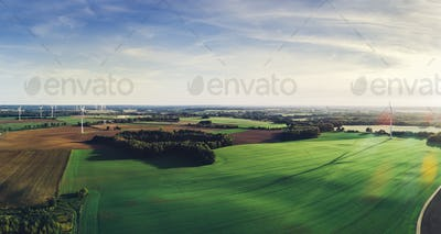 Green meadows with windmills in Poland.