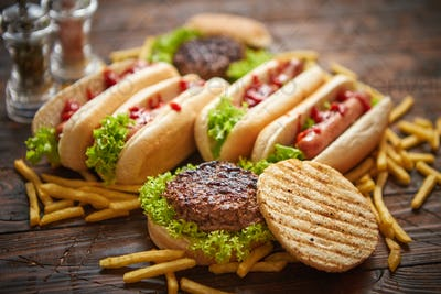 Hot dogs, hamburgers and french fries. Composition of fast food snacks