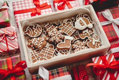 Delicious fresh Christmas decorated gingerbread cookies placed in wooden crate