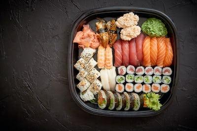 Various kinds of sushi on plate or platter set