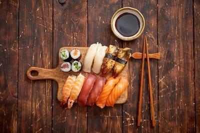 Sushi Set. Different kinds of sushi rolls on wooden serving board