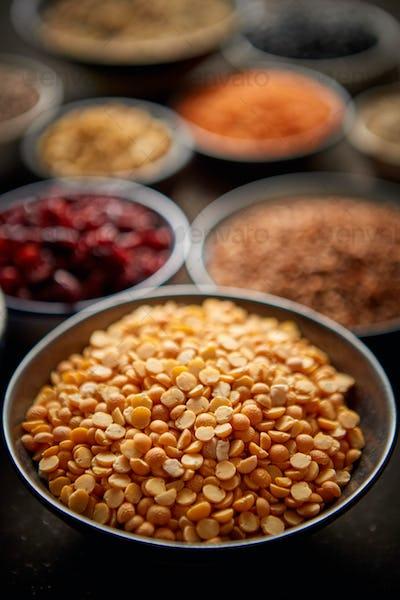 Raw peas halfs seeds in ceramic bowl. Selective focus